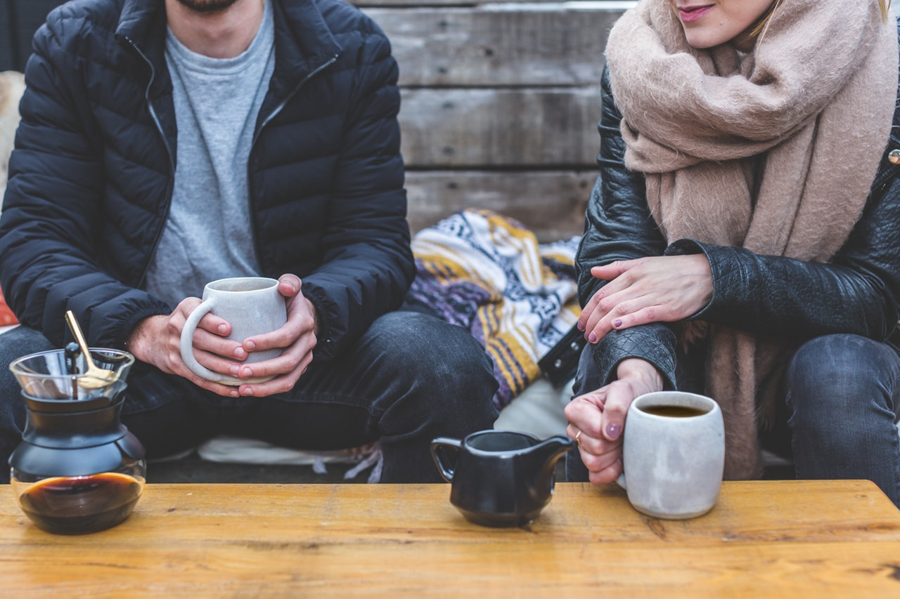 image of two people having a coffee